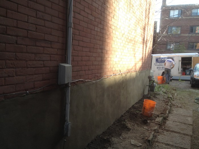 putting the final finish on foundation parging